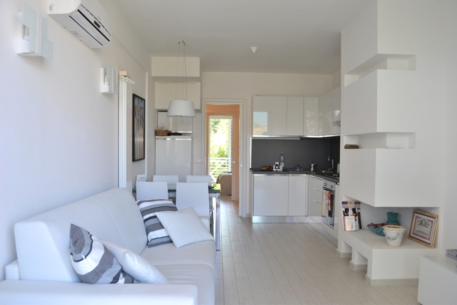Residenza la pisana case nuove moderne e dai consumi for Soggiorno angolo cottura